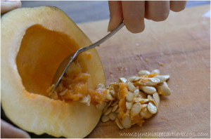 Picture of scooping out the seeds in an acorn squash
