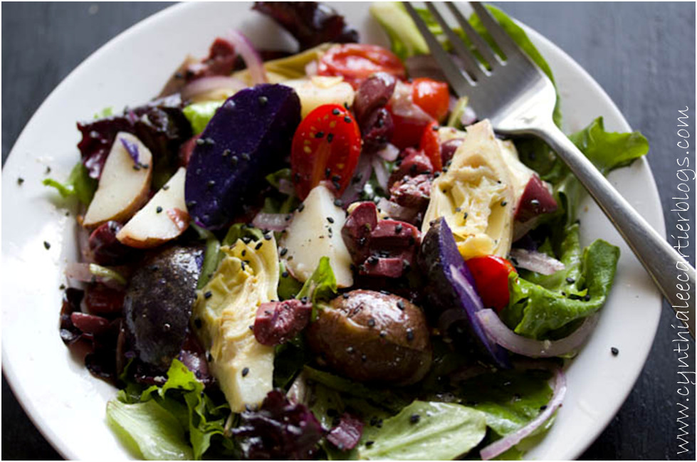 Artichoke Recipes: Colorful Photo of Green salad w/ Artichokes & Purple Potatoes