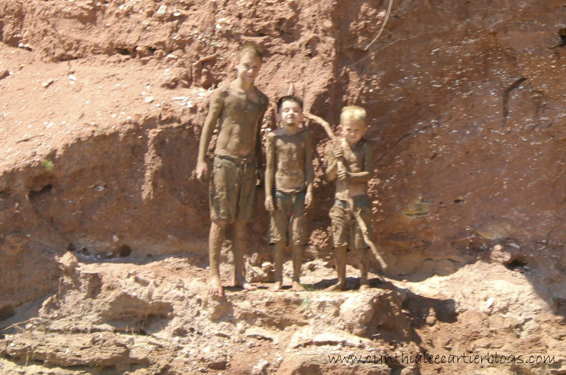 Little boys covered in mud on the Rio Chama in New Mexico