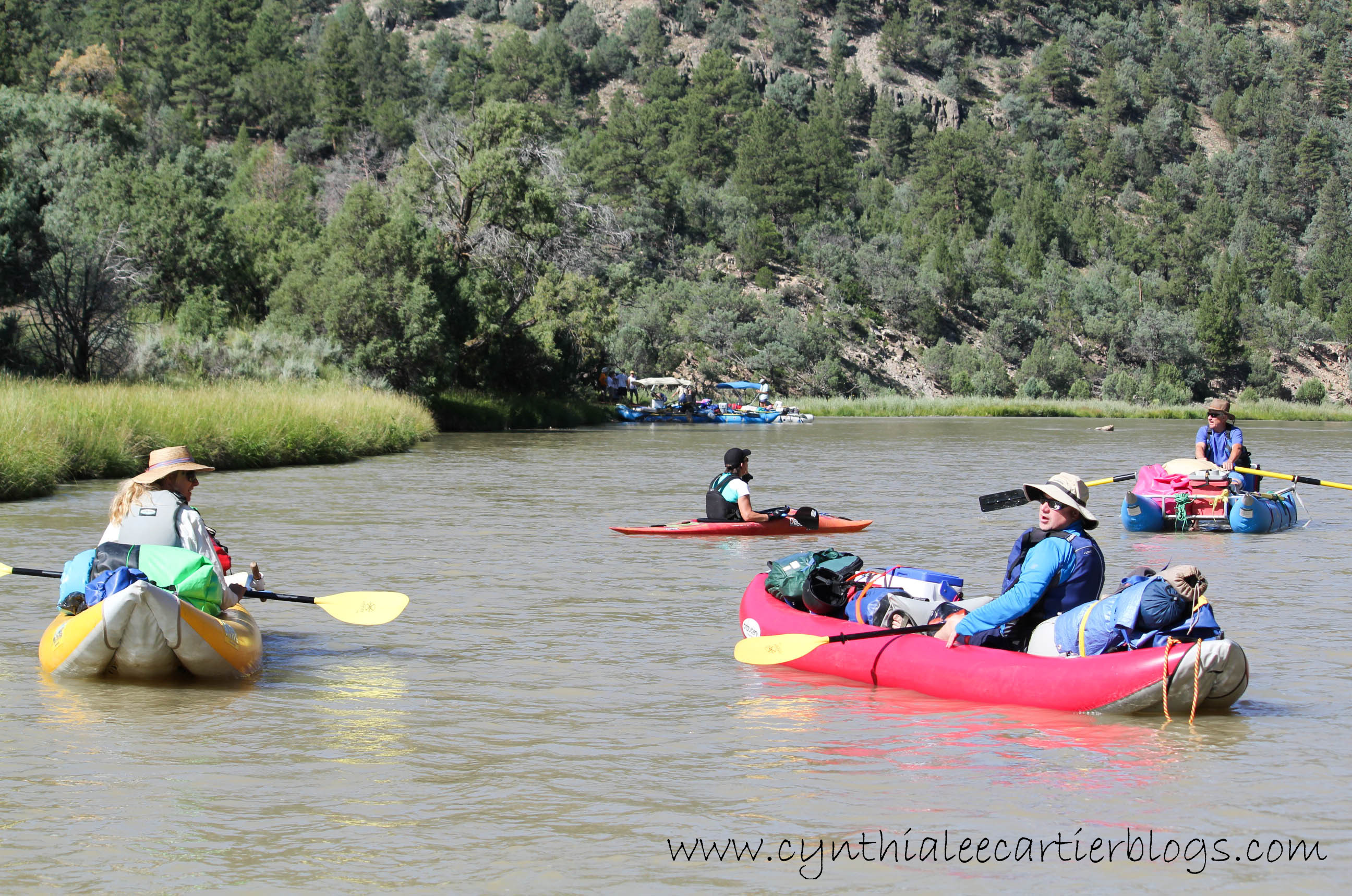 A variety of different kinds of boats on the Rio Chama River